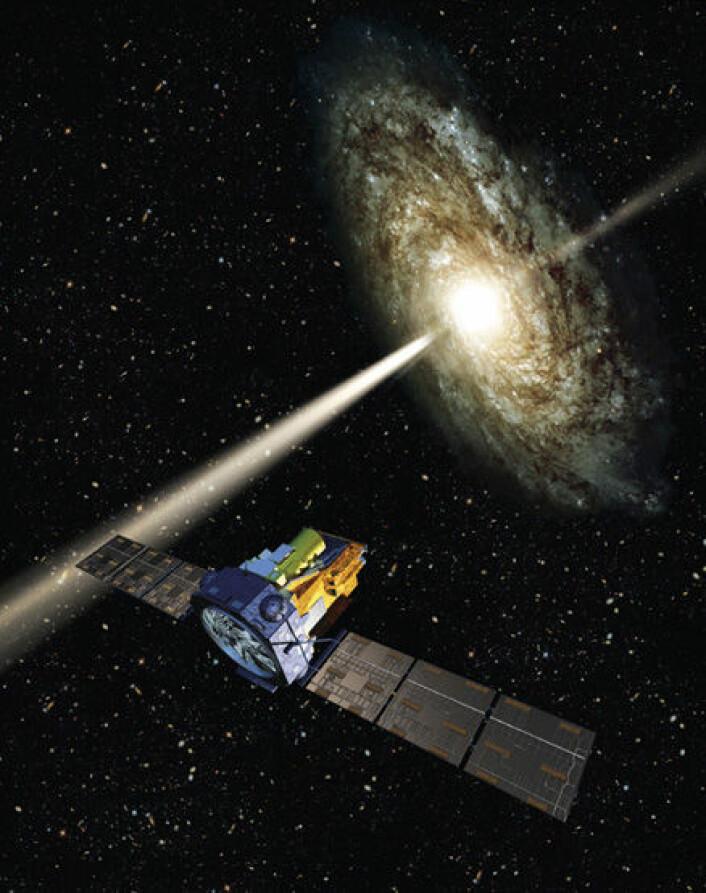 """""""To partikkelstråler skyter ut i hver sin retning fra aktive galaksekjerner. Det er det enorme magnetfeltet rundt galaksekjernen som styrer strømmen av ladde partikler utover til hver side. Slik ser en av ESAs illustratører for seg fenomenet."""""""