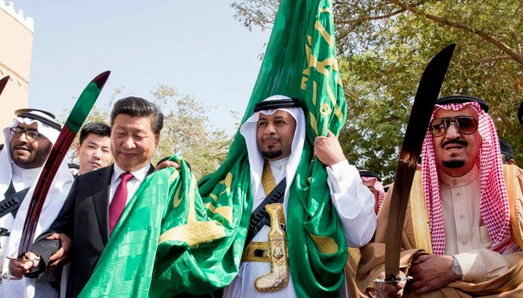 China's President Xi Jinping meets King Salman bin Abdulaziz of Saudi Arabia. Their two countries have become mutually dependent on one another due to China's oil import. Here the two heads of state participate in a traditional dance as part of the welcoming ceremony for the Chinese president's state visit to Riyadh in 2016.