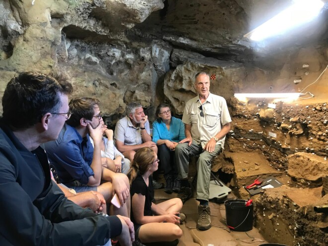LECTURE IN THE FIELD: Professor Henshilwood describes how the sediment in the cave is built up of different cultural layers, formed by the people who lived in the cave.