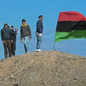 Opprørere utenfor byen Brega i Libya (Foto: VOA - Phil Ittner/Wikimedia Creative Commons)