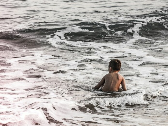 Learning to swim outdoors can be chilly. But that's part of it.