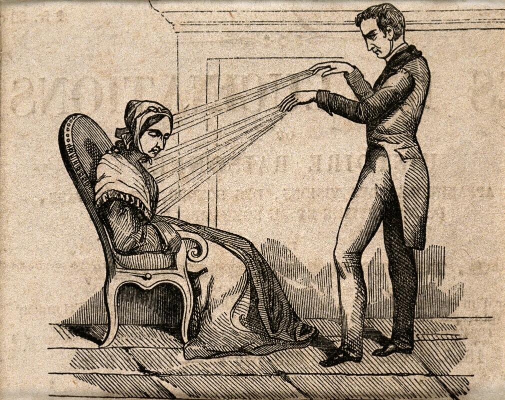En behandler helbreder en kvinne ved hjelp av animalsk magnetisme. Eller kanskje ikke. Blindtester viste at pasientene reagerte da de trodde behandleren rettet den mystiske magnetismen mot dem, uavhengig av om dette faktisk skjedde.