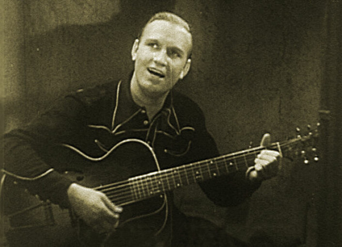 Gene Autry, også kjent som den syngende cowboy eller jodleren fra Oklahoma, her under avsynging av Oh Susannah. (Foto: Joseph Kane, Wikimedia Commons)