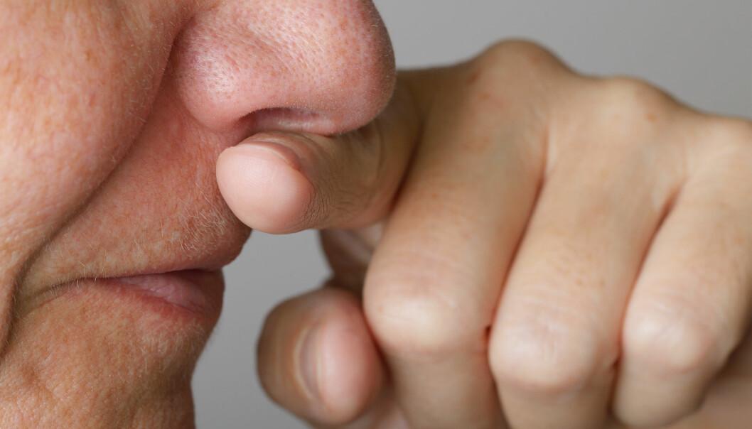 Hvorfor fortsetter du å ta på ansiktet ditt når du vet du burde slutte?