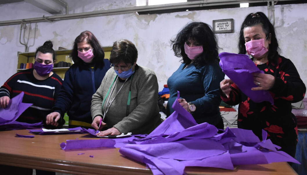 Armenian Syrian volunteers sew masks to distribute to the poor for protection against the coronavirus pandemic, in Syria's northern city of Aleppo, on March 27, 2020.