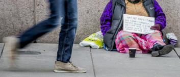 Romfolk som tigger utenfor Stortinget i Karl Johans gate i Oslo sentrum. (Foto: Stian Lysberg Solum / NTB scanpix)