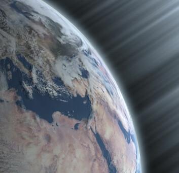 """""""Denne illustrasjonen viser kosmiske stråler som bombarderer Jorden."""""""