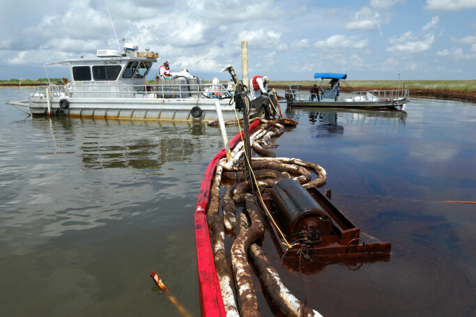 Cleaning up some of the oil from the Deepwater Horizon accident. Oil from the spill coated nearly 1000 km of coastline.