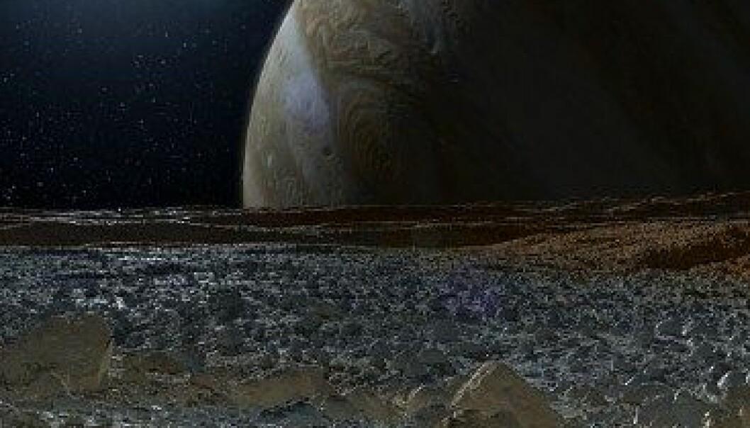 Slik ser NASA for seg at det ser ut på overflaten av Europa, med Jupiter i horisonten. NASA/JPL-Caltech