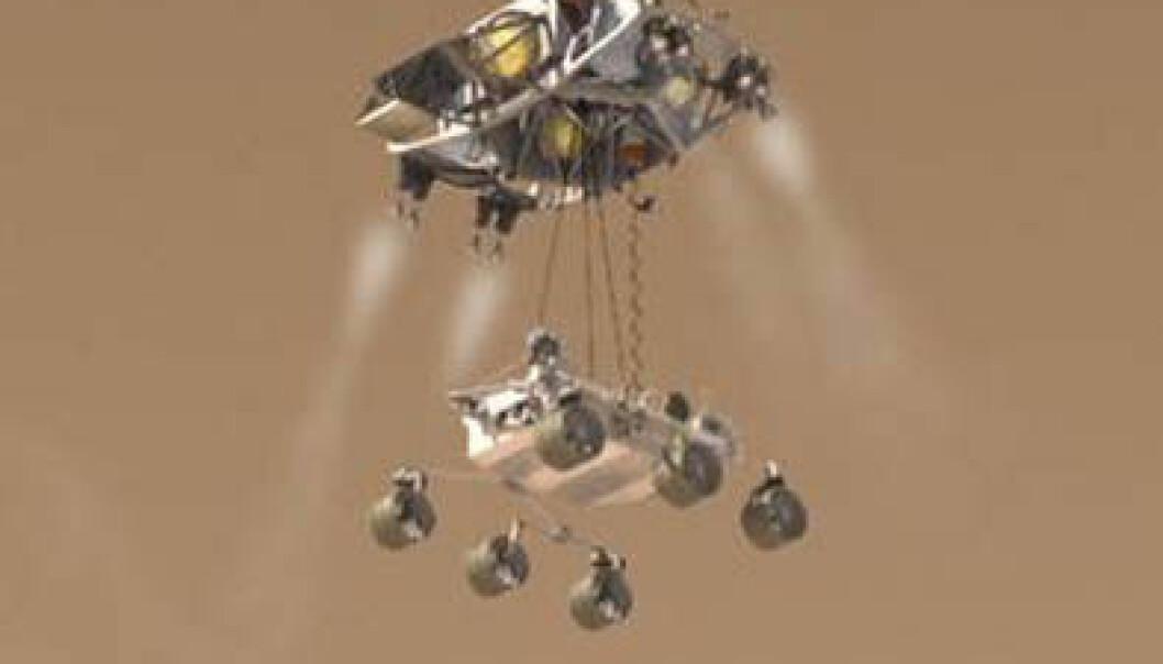 Tidlig om morgenen den 6. august 2012 lander Curiosity på overflaten av Mars ved hjelp av en spesiell svevekran. NASA