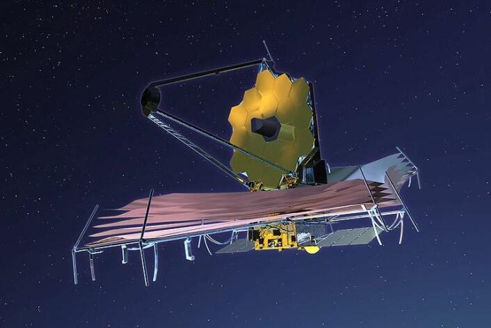 James Webb-teleskopet vil alltid være i skyggen fra jorda og sola, ved hjelp av seilene denne modellen hviler på. De skal stoppe infrarød stråling fra å påvirke sensorene i selve teleskopet, som skal operere i svært lave temperaturer. Om alt går som det skal, vil det kunne se 13,5 milliarder år inn i fortida. (Foto: NASA/Wikimedia commons)