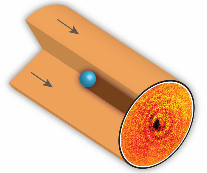 Atomet ble holdt fast av elektriske felter, slik at forsknerne fikk knipset bildet av skyggen dets. (Foto: (Illustrasjon: Griffith University))