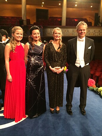 May-Britt and Edvard I. Moser and their two daughters on stage after the Nobel Prize Award Ceremony at the Stockholm Concert Hall, 10 December 2014.