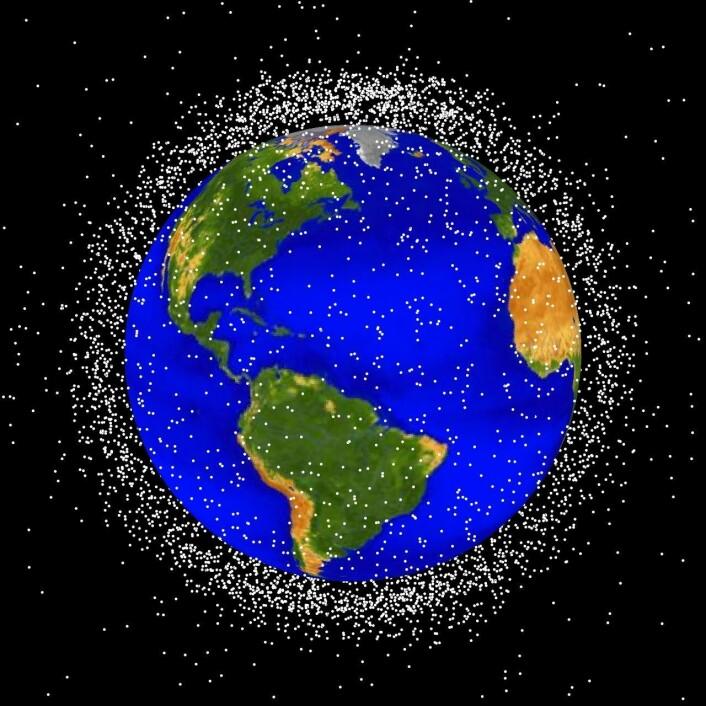 Romsøppel varierer veldig i størrelse. Noen ting er bittesmå, mens andre kan veie tonnevis. Å rydde opp romsøppelet er vanskelig, men kanskje kan en robotarm gjøre jobben. (Foto: (Illustrasjon: NASA))