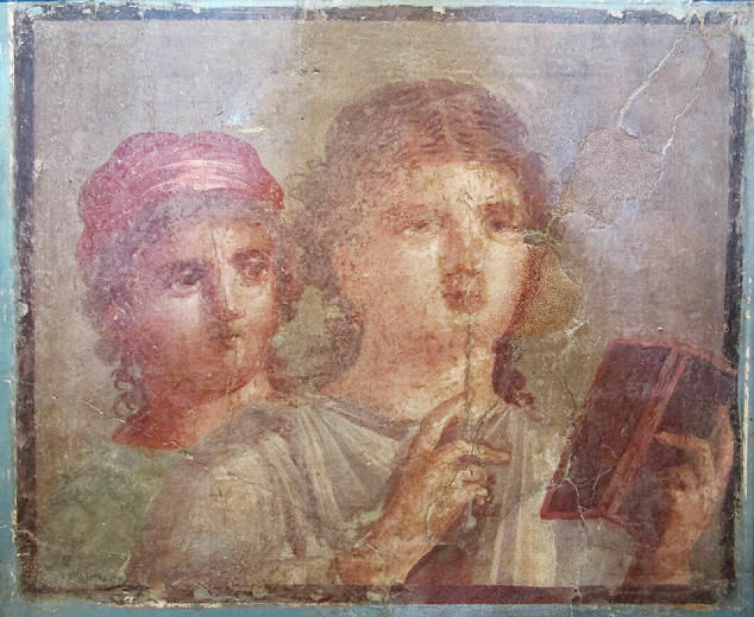 Ancient Roman fresco from Herculaneum depicting two women with a stylus and a wax tablet.