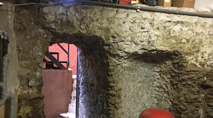 A glimpse of the modern staircase through the ancient aqueduct ruins in the basement of the Norwegian institute in Rome.