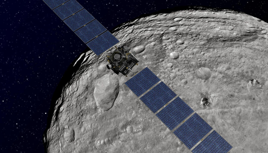 Illustrasjon av romsonden Dawn i bane rundt Vesta. Vesta er laget ut fra bilder tatt av Dawn. (Illustrasjon: NASA/JPL-Caltech)