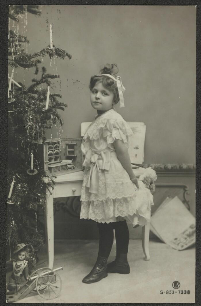 Dette julekortet fra 1906 var et typisk glamourkort, som var moderne på den tiden.
