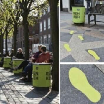 Grønne fotspor leder fotgjengeren mot søppelbøttene – uten å tvinge fram en ubevisst atferd. (Foto: inudgeyou.com)