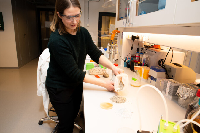 Bacteria-based concrete consists of sand, finely ground limestone and two specific bacteria, mixed with water, urea and nutrients for the bacteria. Here is Simone Balzer Le in her lab.