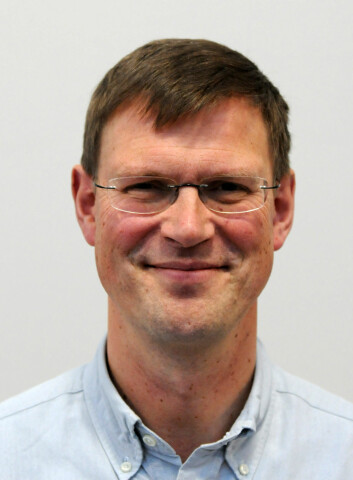 Postdoktor Aksel Mjøs ved Institutt for foretaksøkonomi, NHH. (Foto: NHH)