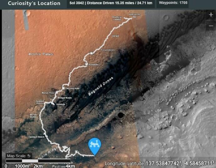 Den hvite linjen viser hele reisen til Curiosity siden den startet. Nå klatrer den opp siden av Mount Sharp, et 5,5 km høyt fjell på Mars.