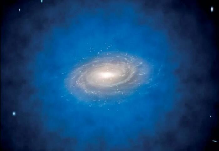 En kunstners tolkning av en galakse innhyllet i en halo av mørk materie, vist i blått.