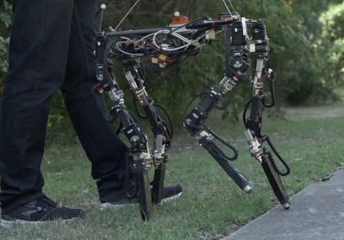 This robot adjusts the length of its legs when stepping from grass to concrete