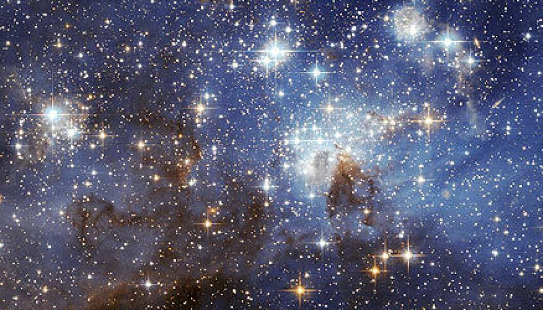 """""""Dette bildet fra romteleskopet Hubble viser for første gang svake nyfødte stjerner i Den store magellanske sky. Foto: ESA/NASA"""""""