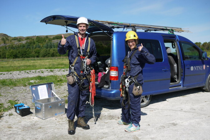 Henrik Jensen, left, and Stefanie Muff, suited up in protective coveralls and climbing gear as they head out to check house sparrow nests on an island off of Helgeland, at the Arctic Circle. They need the climbing gear because the birds nest up high in the eaves of barns. Jensen is a professor in NTNU's Department of Biology and Muff is an associate professor in the university's Department of Mathematical Sciences.