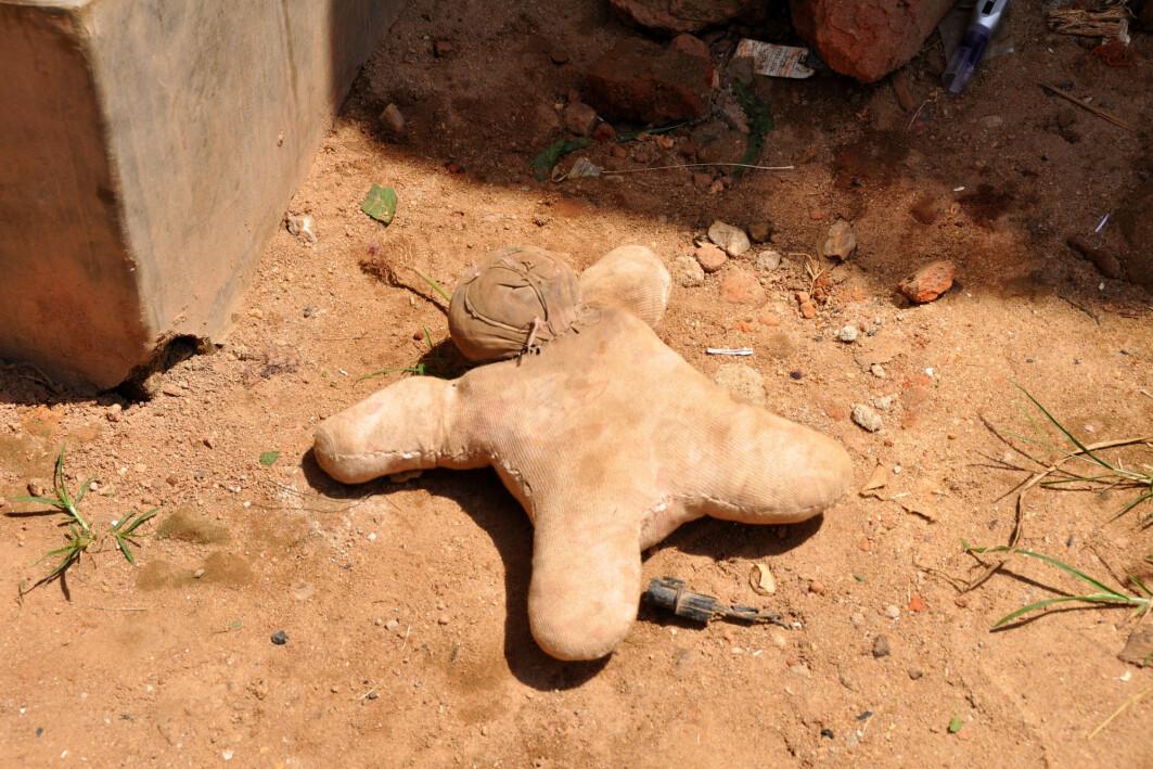 A handmade doll on a dirt road in an urban slum in Uganda.