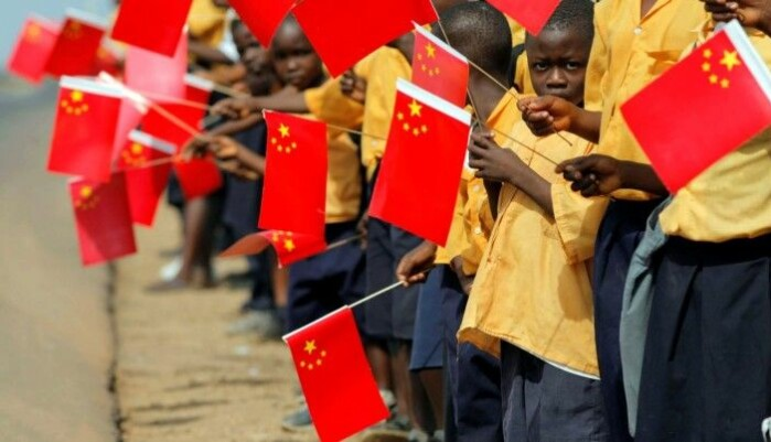 Liberian children holding Chinese flags during a visit by China's former president, Hu Jintao, to Monrovia in 2007.