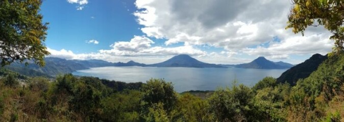 Lake Atitlán covers 127.7 square kilometers. The lake occupies a valley dammed by volcanic ash, it is 320 meters deep, 19 kilometers long and 10 kilometers wide (Britannica).