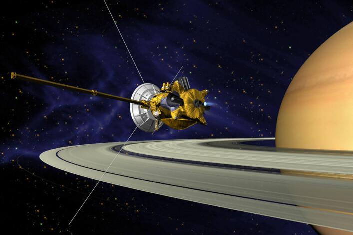 Cassini-sonden og planeten Saturn, med ringene. (Foto: (Illustrasjon: NASA))