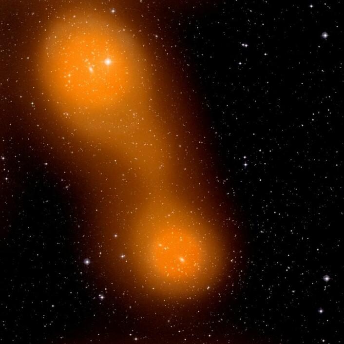 De to galaksehopene Abell 399 (nede til høyre) og Abell 401 (oppe til venstre). Bildet er satt sammen av et bilde i synlig lys som viser galaksene, og et bilde av Sunyaev-Zel'dovich-effekten som viser den varme gassen. Galaksene er de lyse, litt avlange flekkene. Galaksehopene kan sees som de to områdene der det er flest galakser. (Foto: (Illustrasjon: ESA & Planck Collaboration))