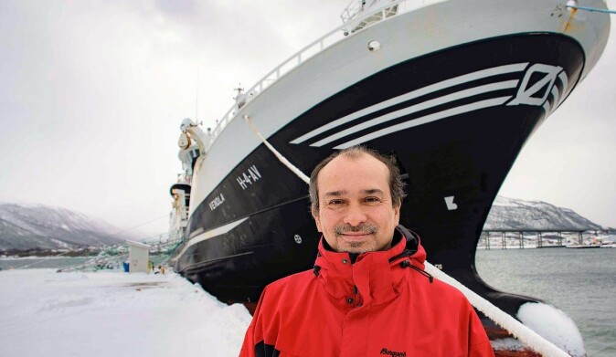Research scientist Héctor Peña stands in front of purse seiner Vendla during a different survey in 2019.