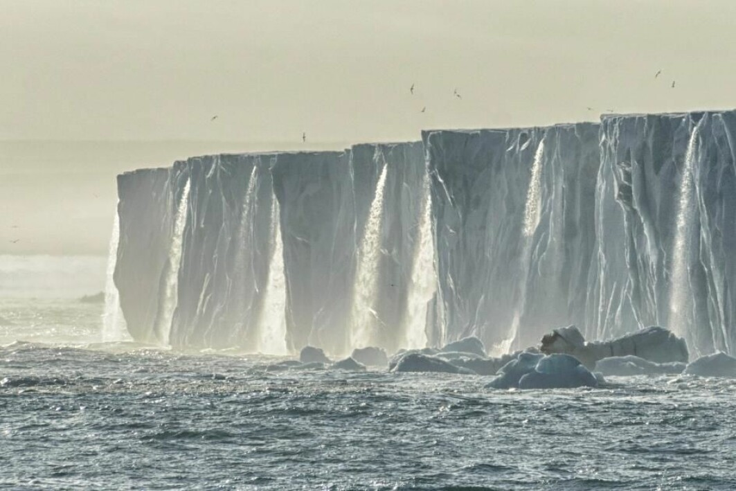Waterfalls of running meltwater from the Bråsvell glacier on Svalbard.