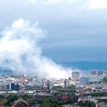 """Oslo 30 minutter etter bomben i regjeringskvartalet om ettermiddagen 22. juli 2011. (Foto: <a href=""""http://en.wikipedia.org/wiki/File:Oslo_view_of_city.jpg"""">Wikimedia Commons</a>"""