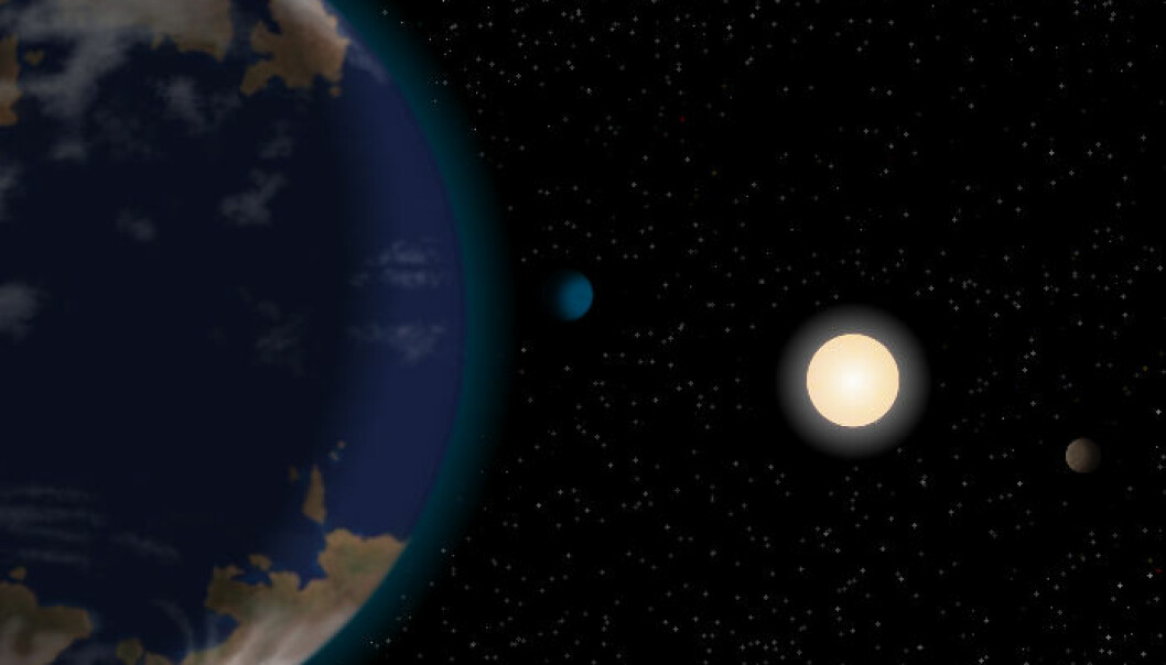 Kunstnerisk framstilling av planeten HD40307g i forgrunnen, med dvergstjernen HD40307 og to av de andre planetene i systemet bakenfor. Atmosfæren og kontinentene er foreløpig rein fantasi. (Illustrasjon: J. Pinfield/ RoPACS network, University of Hertfordshire)