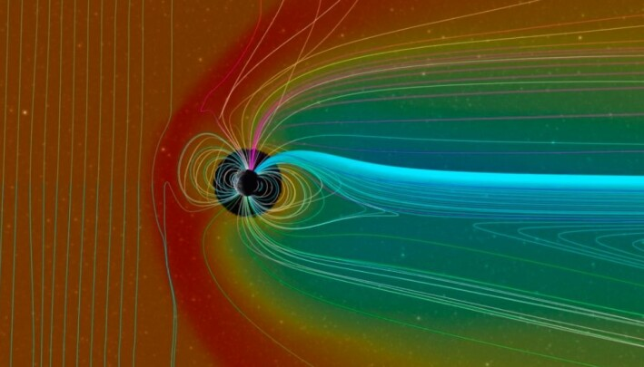 En modell som viser magnetfeltet rundt jorda (sirkelen i midten) , og hvordan det bøyer av kraftig solvind, som er representert ved det røde fargen. Magnetfeltene er representert ved alle linjene. Solvinden kommer altså fra venstre.