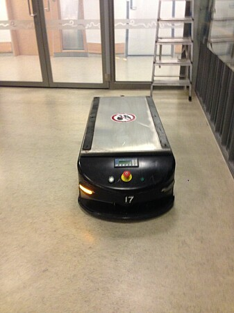 This rectangular box on wheels is a robot that transports trolleys around the hospital. Surprisingly, when people hear it talk, they see it as a kind of funny animal-like creature — and not really a robot.