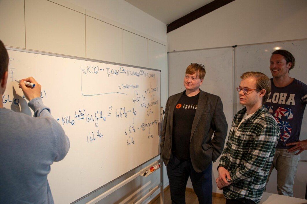 Paul Arne Østvær, professor of mathematics at the University of Oslo (UiO) together with three of his project participants at CAS.