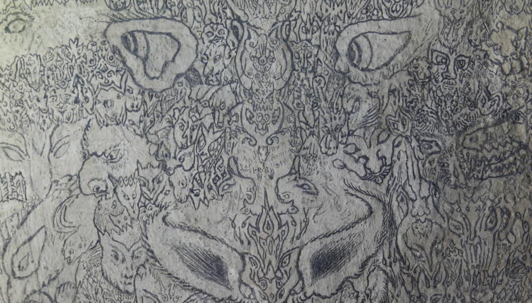 Ansikter, masker og demoner i demoner. Detalj fra demonveggen i Sauherad kirke.