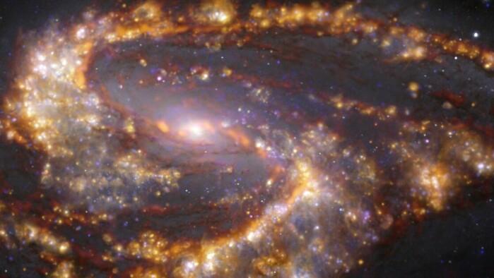 Galaksen NGC 3627, 31 millioner lysår fra jorden. Her er bildene fra ALMA og VLT kombinert.