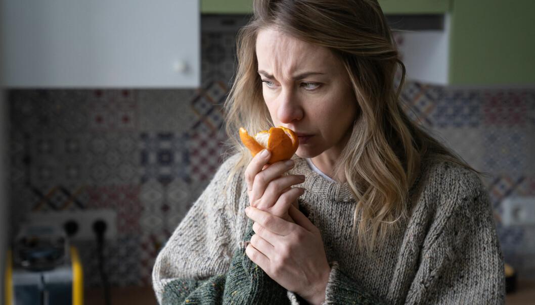 Sick,Woman,Trying,To,Sense,Smell,Of,Fresh,Tangerine,Orange,