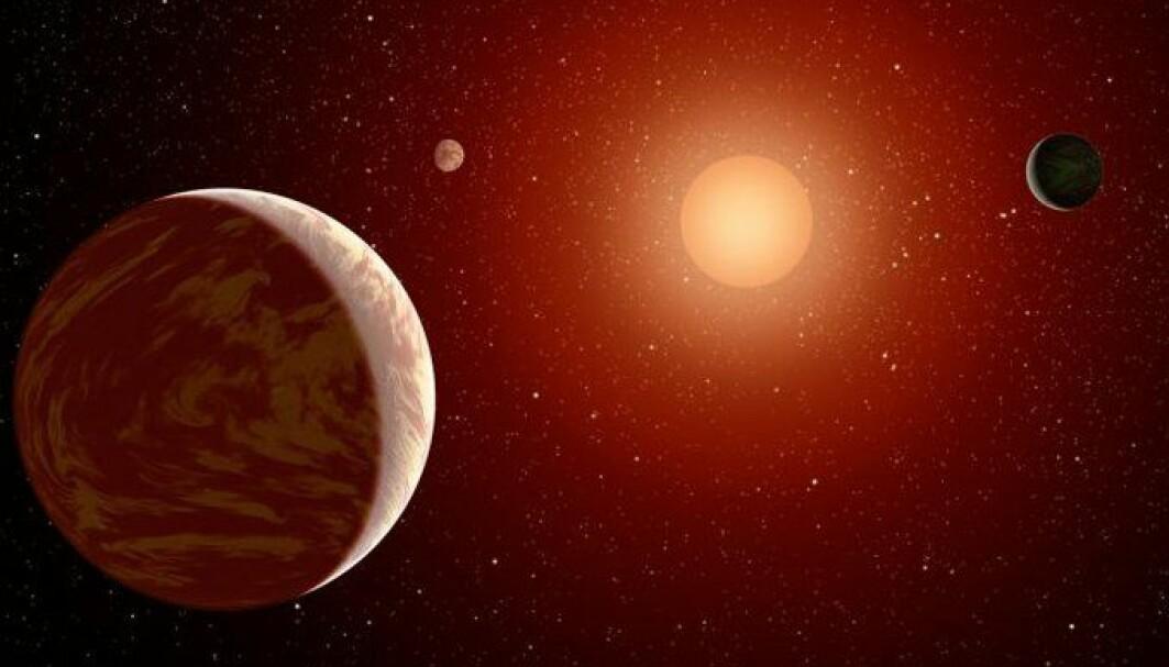 Slik ser en kunstner for seg at et planetsystem rundt en rød dvergstjerne kan se ut