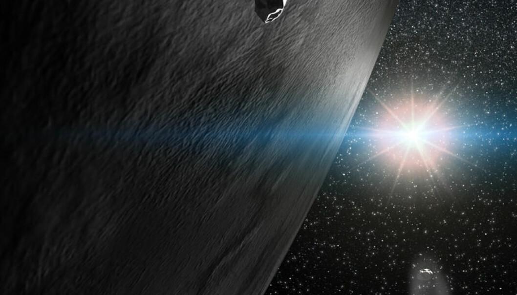 Kunstnerens inntrykk av asteroiden Themis og to små fragmenter av denne asteroidefamilien, som oppstod fra et stort sammenstøt for mer enn en milliard år siden. Legg merke til at ett av fragmentene har steinoverflate, mens det andre har en kometlignende hale, som kommer av at is fra overflaten fordamper. (Illustrasjon: Gabriel Pérez, Servicio MultiMedia, Instituto de Astrofisica de Canarias, Tenerife, Spania)