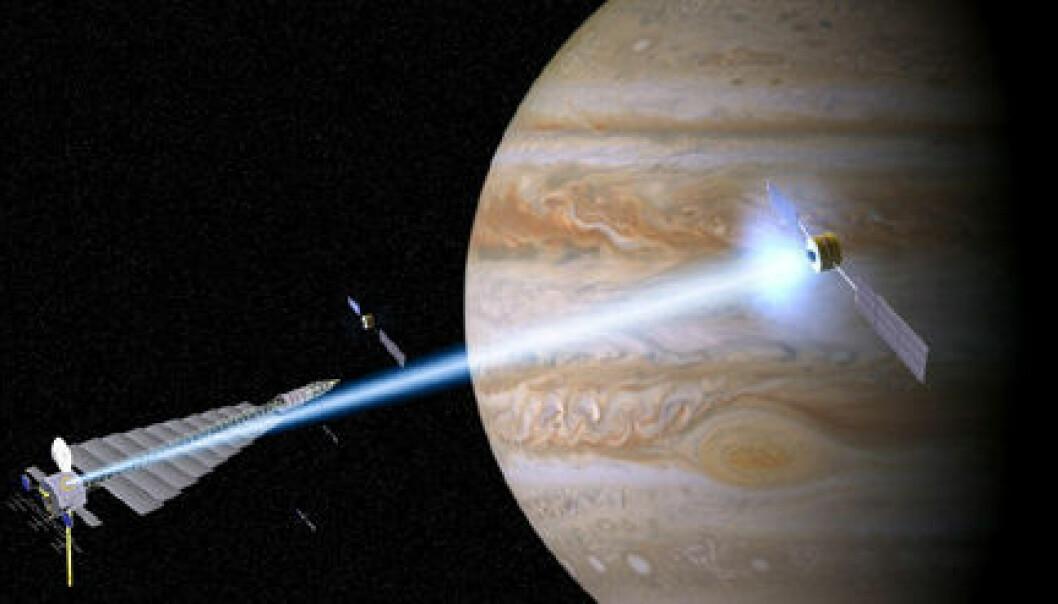 """""""En illustrasjon som viser en plasmastasjon (nede til venstre) som sender en magnetisert stråle med ionisert plasma til et romfartøy. (Illustrasjon: John Carscadden, University of Washington)"""""""
