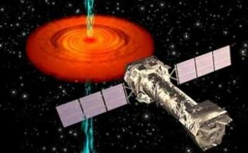 Illustrasjon av XMM-Newton med et sort hull i bakgrunnen. (Illustrasjon: ESA)