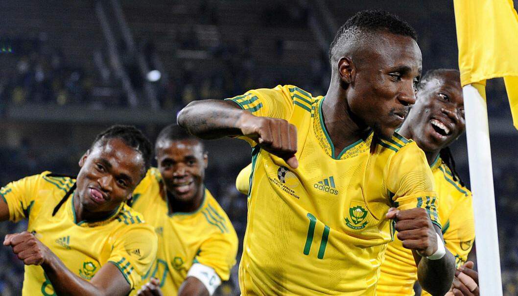 Etter 5-0 i kampen mot Guatemala rett før VM, var det all grunn til å feire for de sørafrikanske spillerne.  (Foto: Gianluigi Guercia, AFP)